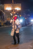 New Orleans, LA/USA - circa February 2016: Man carrying candles and fire duringMardi Gras parade in New Orleans,  Louisiana Stock Images