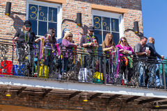 New Orleans, LA/USA - circa February 2016: People throwing beads from balconies during Mardi Gras in New Orleans,  Louisiana Stock Image