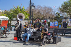 New Orleans, LA/USA - circa February 2016: Young band of musicians perform at Jackson Square, French Quarter, New Orleans Royalty Free Stock Photos