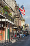 New Orleans, LA/USA - circa March 2009: Old Colonial House with ironwork galleries and american flag stock images