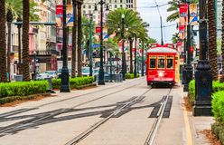 Tram pubic transport on Canal street in New Orleans, Louisiana. New Orleans, Louisiana - February 6, 2017: Tram pubic transport on Canal street royalty free stock photography