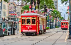 Tram pubic transport on Canal street in New Orleans, Louisiana. New Orleans, Louisiana - February 6, 2017: Tram pubic transport on Canal street stock image