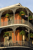New Orleans, Louisiana - July 13, 2015: A French-inspired building with iron balconies in French Quarter, New Orleans, Louisiana. Royalty Free Stock Photo