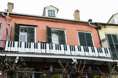 New Orleans, Louisiana - July 8, 2015: A historic building with piano keys decoration on Royal Street in New Orleans. Royalty Free Stock Photos