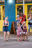 New Orleans, Louisiana - July 13, 2015: People cheer and dance at music played by local band in French Quarter, New Orleans, Louis Royalty Free Stock Photo