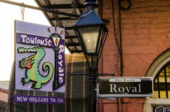 New Orleans, Louisiana - July 13, 2015: Royal street sign and food business sign in French Quarter of New Orleans Stock Image