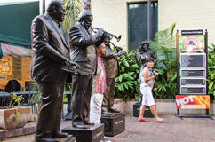 New Orleans, Louisiana - July 8, 2015: Statues of famous jazz players, Antoine Fats Domino, Al Jumbo Hirt and Pete Fountain. Stock Photography