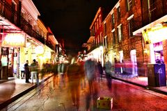 Pubs and bars with neon lights in the French Quarter, New Orleans Louisiana stock photos