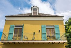 Picturesque facades of old mansions in the French Quarter. New Orleans, Louisiana, USA. Tourist excursion to the sights of the anc stock image