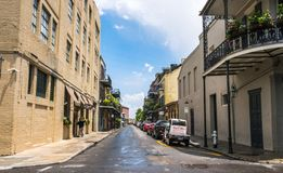 Streets of the ancient French Quarter in New Orleans, Louisiana. The ancient colonial mansions and tourists on the street in New O royalty free stock photo
