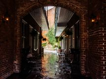 Picturesque old street cafe. The charm of the French Quarter in New Orleans, USA. New Orleans, Louisiana, USA - June 25, 2017: street cafe on an old narrow royalty free stock image