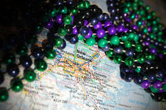 New Orleans. Mardi Grad beads atop a map of New Orleans, Louisiana royalty free stock photo