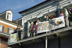 New Orleans Mardi Gras 2010. Mardi Gras revelers hang out on a balcony on Bourbon Street in the French Quarter of New Orleans, Louisiana.  Because of the recent Stock Photo