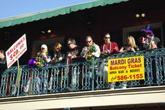 New Orleans Mardi Gras 2010. Mardi Gras revelers fill the balconies along Bourbon Street in the French Quarter of New Orleans, Louisiana.  People in balconies Royalty Free Stock Image