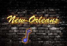New orleans neon. Neon style New Orleans sign with musical note on grunge brick background stock photos