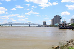 New Orleans paddle steamer in Mississippi river. Bridge Royalty Free Stock Images
