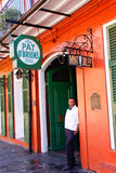 New Orleans Pat OBriens Bar. An employee takes a break outside of world famous Pat O'Brien's bar, a local landmark known for it's dueling piano bar and as the Stock Image
