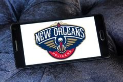 New Orleans Pelicans American basketball team logo. Logo of New Orleans Pelicans team on samsung mobile. The New Orleans Pelicans are an American professional Royalty Free Stock Photo