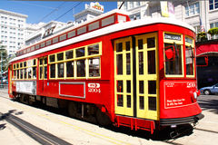 New Orleans Red Canal Street Car. One of the many bright red and yellow easily accessible street cars running on Canal Street along the edge of the French Stock Image