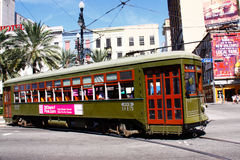 New Orleans St. Charles Street Car Along Canal St. The historic green St. Charles Avenue street car running along the edge of the French Quarter along Canal Royalty Free Stock Images