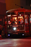 New Orleans St. Charles Street Car at Night. One of the historic green St. Charles Avenue street cars at night running along the edge of the French Quarter and Royalty Free Stock Photography
