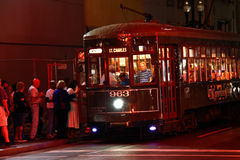 New Orleans St. Charles Street Car Night Crowds. One of the historic green St. Charles Avenue street cars at night running along the edge of the French Quarter stock images