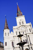 New Orleans St Louis Cathedral and Fountain. A beautiful morning view of the water fountain in front of the historic St. Louis Cathedral from Jackson Square in Stock Photo