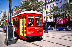 New Orleans Street Car. One of the many bright red and yellow easily accessible street cars running on Canal Street along the edge of the French Quarter and Royalty Free Stock Images