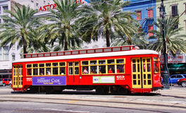 New Orleans Street Car Historic Canal Street. One of the many bright red and yellow easily accessible street cars running on Canal Street along the edge of the Stock Photography
