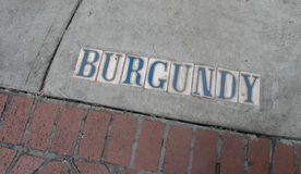 New Orleans Street Sign- Burgundy - French Quarter Royalty Free Stock Photos