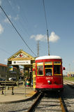 New Orleans streetcar. Red Streetcar in New Orleans at Dumaine Street at the riverfront Stock Photos
