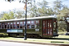 New Orleans Streetcar Rushing By. Historic St Charles Avenue Streetcar whizzing by in Uptown New Orleans Royalty Free Stock Photo