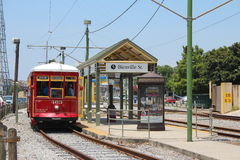 New Orleans Train station. Streets of New Orleans, Louisiana, USA: Train station with typical red tram parked next to it. Bienville Street is right next to the royalty free stock photography