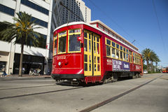 New Orleans Trolley. Bright red and yellow trolley along Canal Street in New Orleans used to transport residents and tourists from the French Quarter to other Stock Photos