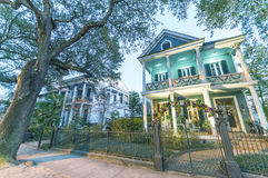 NEW ORLEANS, USA - FEBRUARY 2016: Beautiful colourful homes alon. G city streets. New Orleans attracts 10 million tourists annually Stock Images