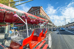 NEW ORLEANS, USA - FEBRUARY 2016: Red horse carriage along Jacks. On Square. New Orleans attracts 10 million tourists annually royalty free stock photos