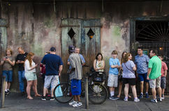 New Orleans, USA - July 13, 2015: Crowd of people stand in line for music performance in local bar on Bourbon Street, New Orleans. Royalty Free Stock Image