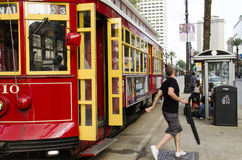 New Orleans, USA - July 8, 2015: People get off from a Canal Street line streetcar in the downtown of New Orleans, Louisiana. Royalty Free Stock Photos