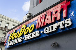 New Orleans, USA - July 8, 2015: A sign of VooDoo Mart, a store selling alcohol and food on Canal Street, New Orleans, Louisiana. Stock Image