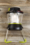 New outdoor battery lantern on rustic wooden boards Royalty Free Stock Image