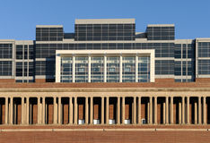 New over old architecture. Contrast of new skyboxes on top of the old columns of Memorial Stadium on the campus of the University of Illinois at Urbana-Champaign Royalty Free Stock Images