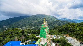 New pagoda on hilltop at Patong beach. New construction pagoda at Thepmongkolnimit temple on hilltop at Patong.on the high mountain you can see all around Patong Royalty Free Stock Images