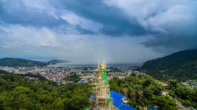 New pagoda on hilltop at Patong beach. New construction pagoda at Thepmongkolnimit temple on hilltop at Patong.on the high mountain you can see all around Patong Royalty Free Stock Image