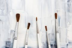 Free New Paint Brushes On Black And White Canvas Royalty Free Stock Photo - 121212605