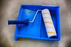 New paint roller with blue paint tray. Stock Images