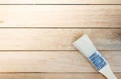 New paintbrush on blank wood background.  stock photo