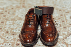 A new pair of tan leather shoes, belt Royalty Free Stock Photos