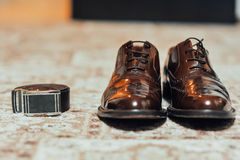 A new pair of tan leather shoes, belt Stock Images