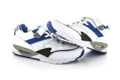 New pair of white and blue trainers Royalty Free Stock Image