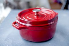 A new pan made of thick red iron. On a gray stone background. Free space for writing a test royalty free stock image